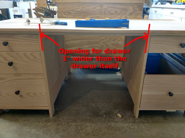 Illustration showing the width of the drawer opening in the desk