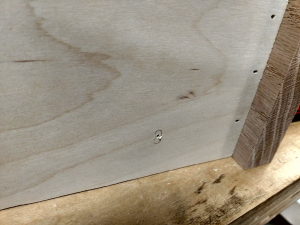 Pilot hole drilled in the side of the drawer