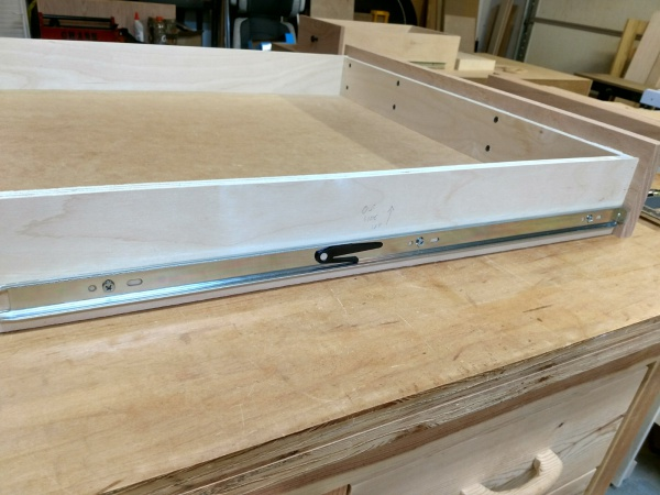 Full extension drawer slide installed on the side of the drawer