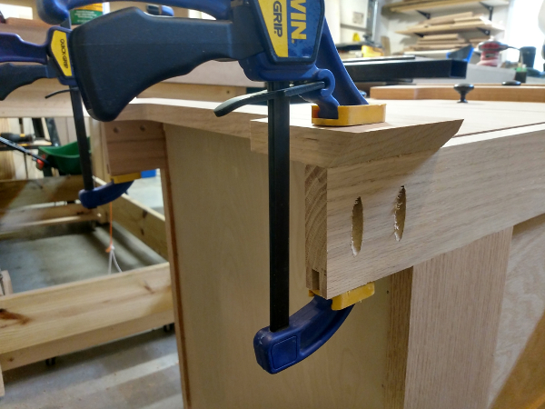 Baseboard glued and clamped on furniture ready for pocket screws