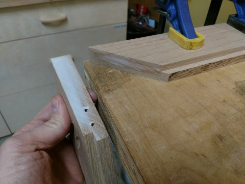 Applied glue to the miter joint prior to clamping and screwing