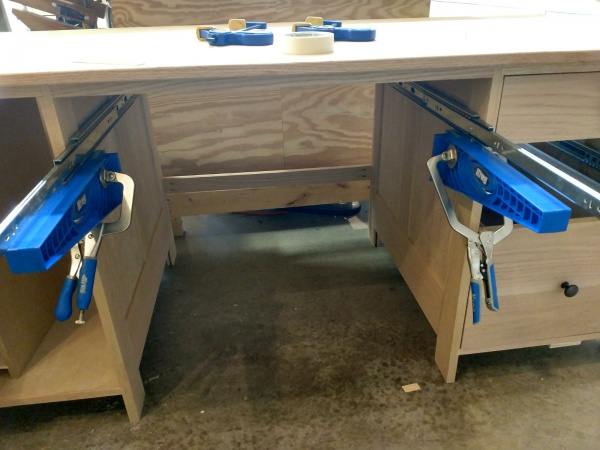 Both drawer slide jigs clamped in place with slides extended out