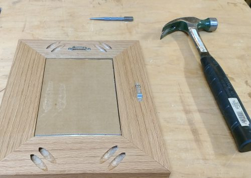 Picture frame after I've attached the sawtooth hangers