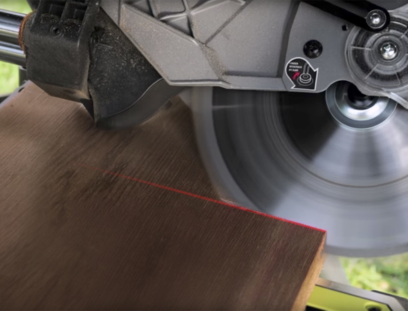Ryobi miter saw with laser guide marked on board