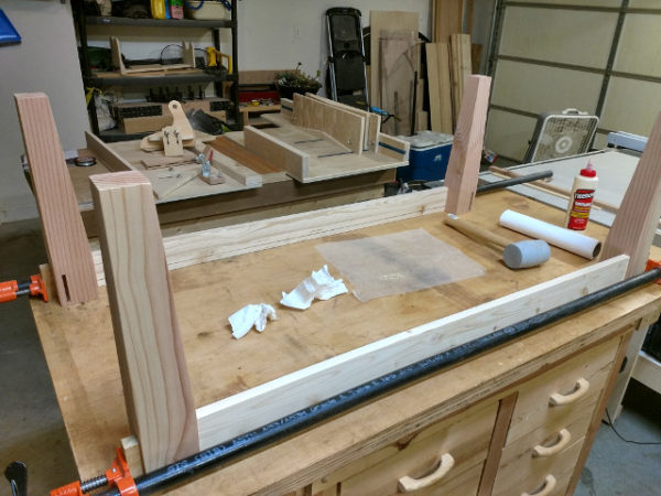 Gluing the legs to the long aprons using pva glue and pipe clamps