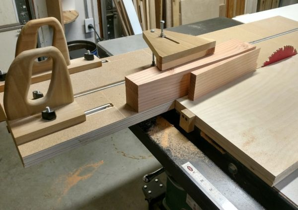 Coffee table legs getting tapered using this table saw sled