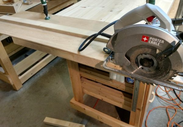Crosscutting this table top end flat using a circular saw and jig