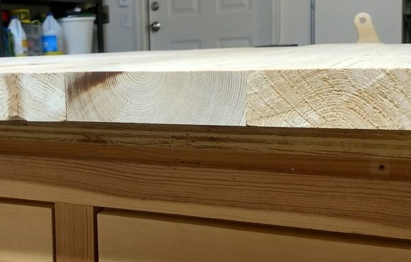 Panel boards on a coffee table top laid out so the grain direction alternates