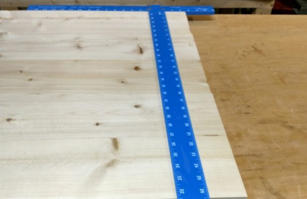 Marking table top for crosscut using a square
