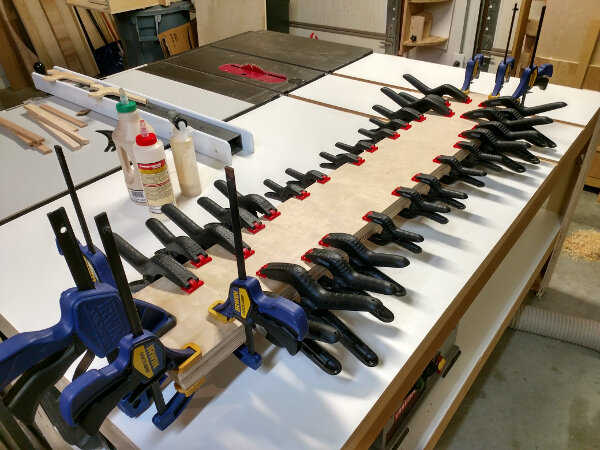 Fence stock being glued and clamped