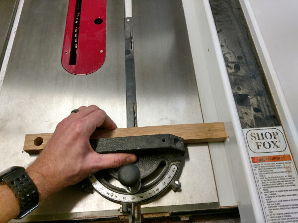 Using scrap wood to tune your table saw fence, step 1