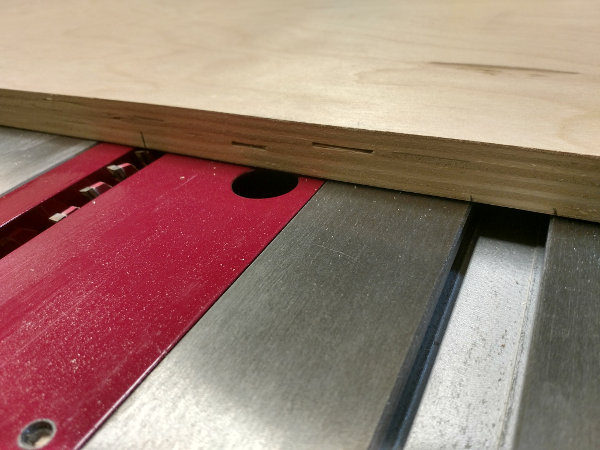 Mark edges of the sled for the miter slot locations