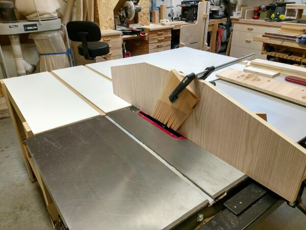 using a feather board for cutting the cabinet plywood