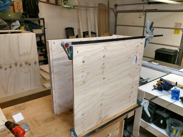Securing sides to the base of the narrow cabinet