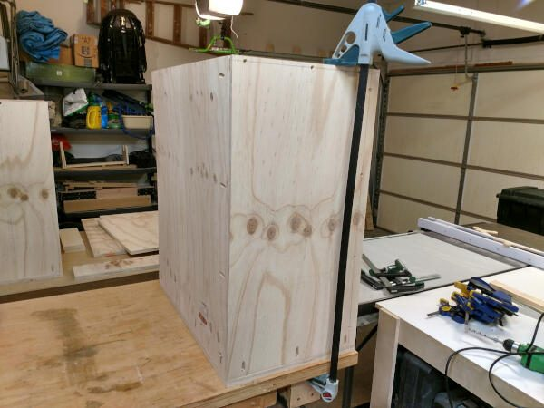 Securing the back to the base of the narrow base cabinet