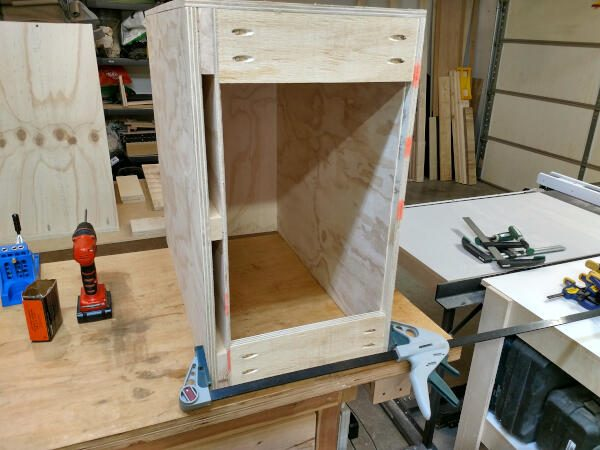 Securing the cleats to the narrow base cabinet