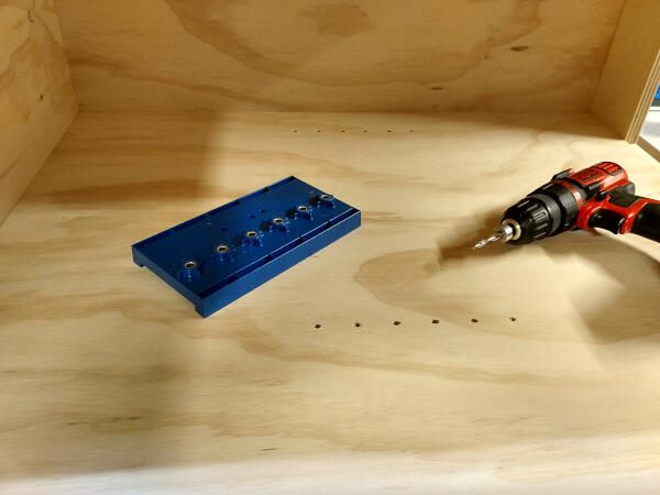 shelf pin holes drilled in cabinet walls
