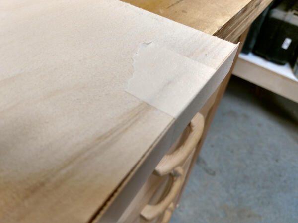 veneer edge banding taped to shelf