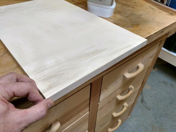 holding the other side of veneer flush on shelf edge