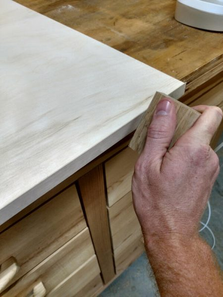 finishing the glue process of the veneer