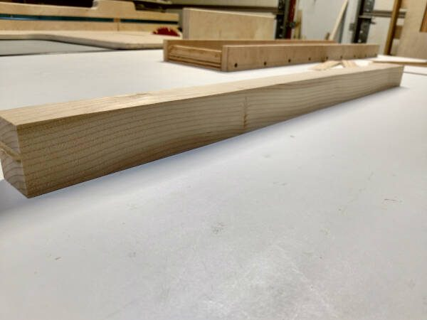 squared and planed rough cut board
