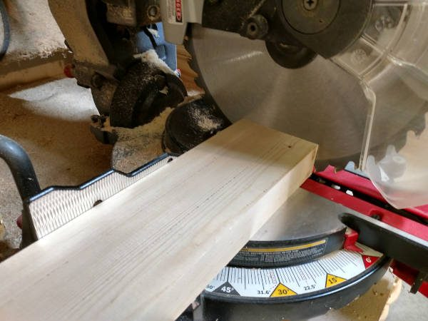 cross cutting board to square it up with miter saw