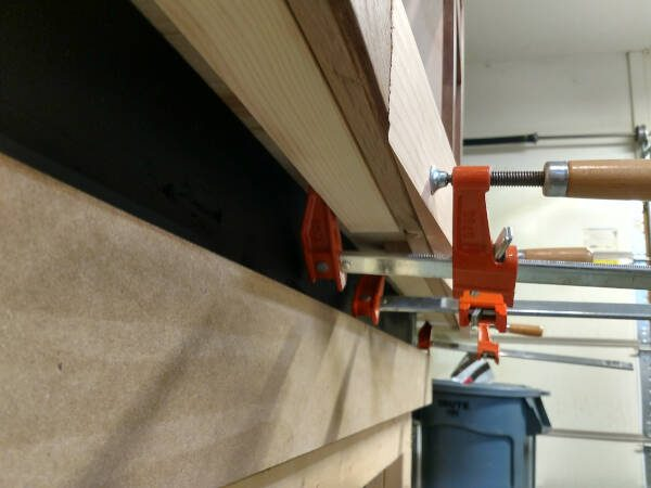 lower rail clamped to cabinet