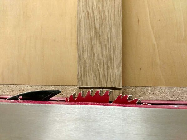adjusting blade height to match tongue shoulder for cabinet doors
