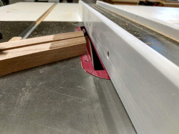 using a feather board to cut grooves