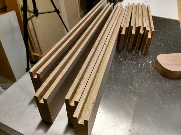 Grooves cut in the rails and stiles for the cabinet doors