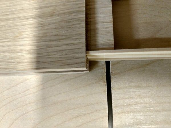 Marking gauge on tongue to line up cut for cabinet doors frame