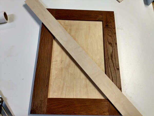 Cutting the first strip for the X on cabinet doors