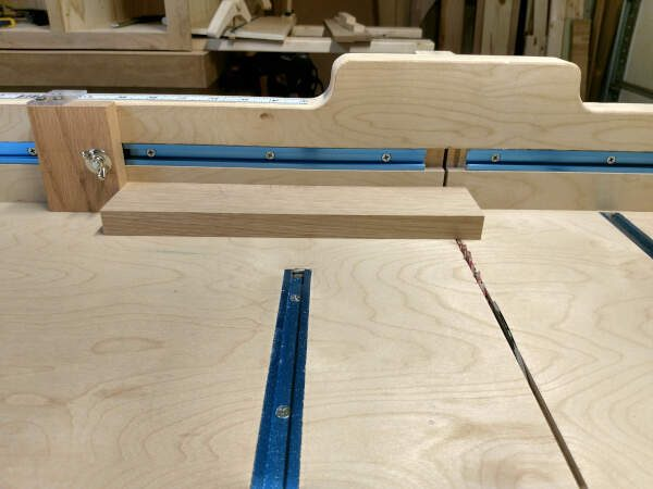 Using stop block to cut tongues on cabinet door rails