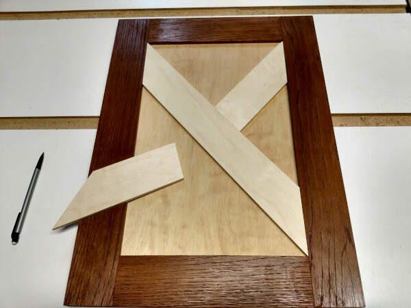 X pieces going together in cabinet door