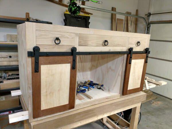 Cabinet doors attached with barndoor hardware