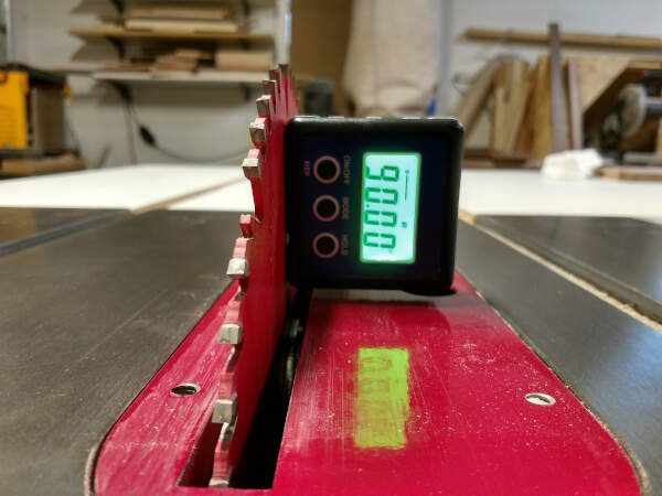 digital level used to align the table saw blade for panel glue ups