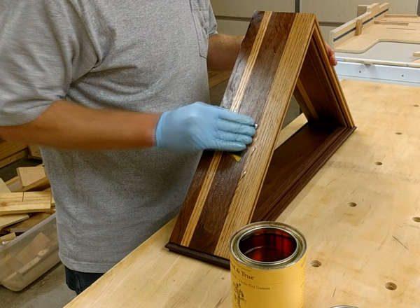 applying a slurry coat of danish oil with sandpaper