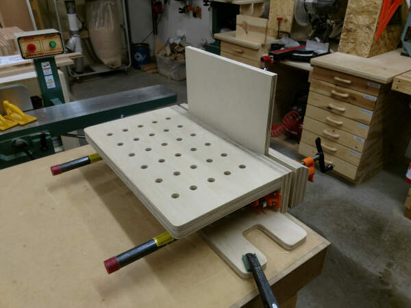 Plywood clamped in place to be edge banded