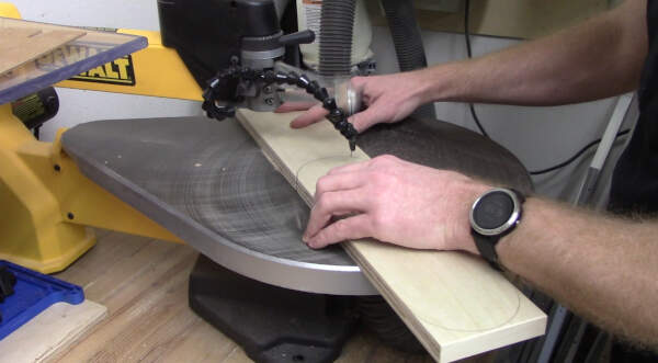 cut the throat plate curves with a scroll saw