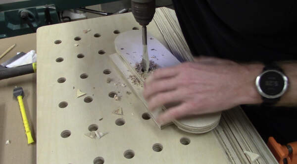 drill a finger hole in the table saw insert