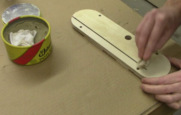 apply paste wax to your zero clearance table saw insert