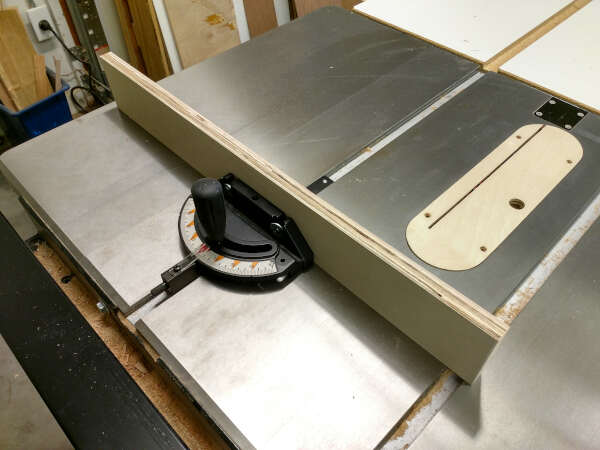 sacrificial fence screwed to table saw miter gauge