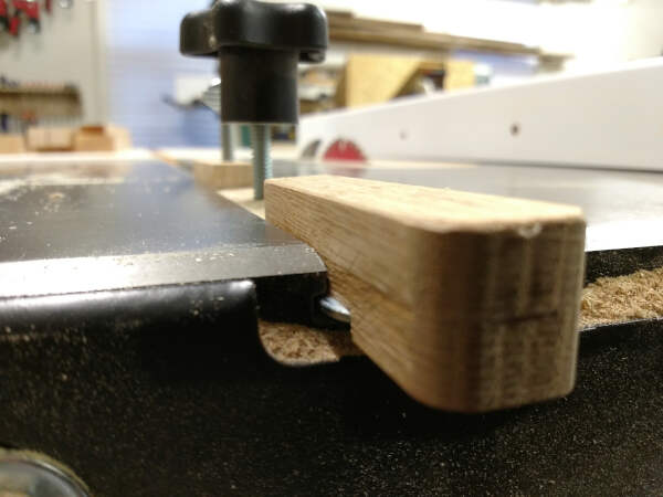 miter bar inserted into table saw